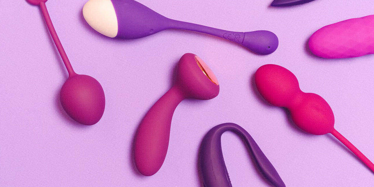 Purple sex toys on a light purple background