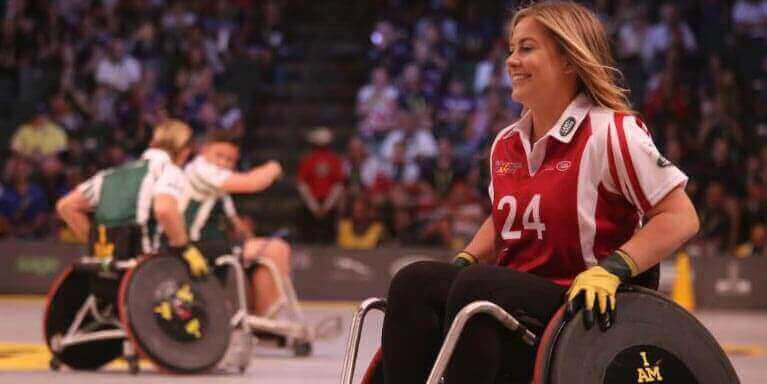 Photo of 3 people in wheelchairs playing sports